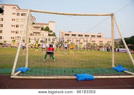 Zhongshan, China - March 19 Kids Playing At A Friendly Soccer Game On March 19, 2015 In Zhongshan, C