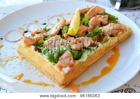 Belgian waffle with arugula, cream sauce and roasted salmon