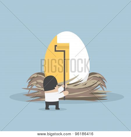 Businessman Painting Golden Color On The Egg
