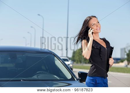 Beautiful young businesswoman is talking on the telephone