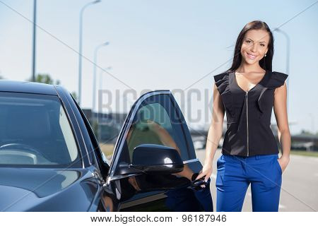 Cheerful young businesswoman is waiting for her colleague