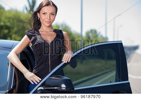 Pretty young woman is ready to drive