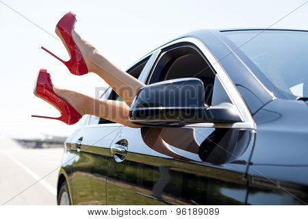 Young sexy girl is relaxing in her vehicle