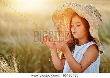 Preschool Girl In A Ripe Wheat Field