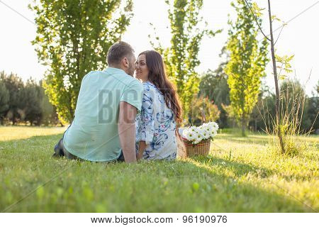 Cheerful young lovers are resting in the nature