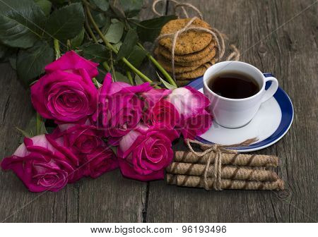 Cup Of Coffee, Cookies And Bouquet Of Scarlet Roses