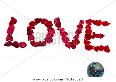 Inscription Love From Petals Of Roses And Nearby The Globe