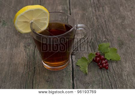 Glass Of Tea, Segment Of A Lemon And Branch Of Currant