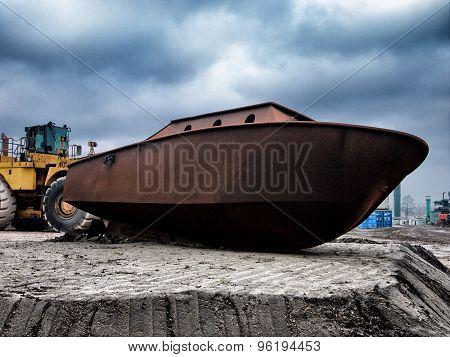 Unpainted ship on shore