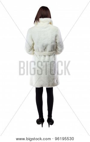 Image of woman in white fur coat, from back