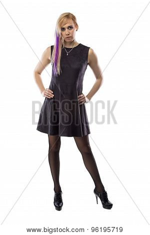 Woman in artificial suede dress, hands on hips