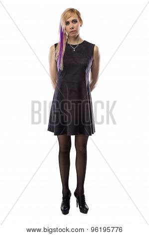 Woman in artificial suede dress, hands behind back