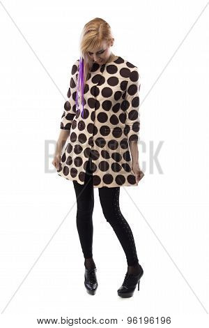 Image of smiling woman in spotted coat