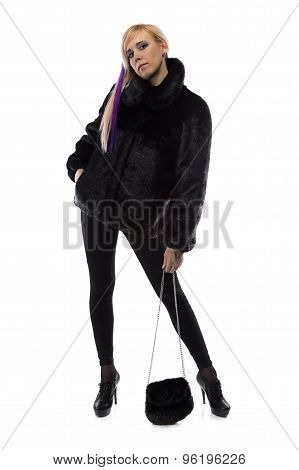 Image of woman with fur bag, chin up