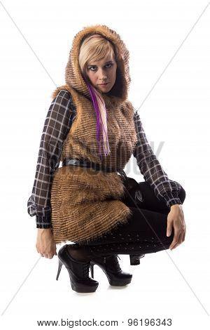 Sitting blonde in brown fur jacket with hood