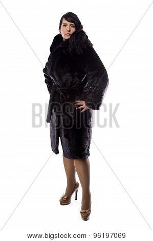 Image of pudgy brunette in black coat