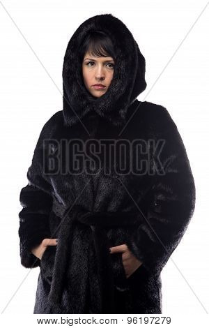 Image of brunette in black fur coat