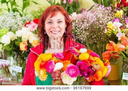Florist selling flowers and bouquets in shop