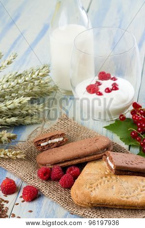 Cereal Biscuits And Raspberries In Front Of Yogurt And Milk
