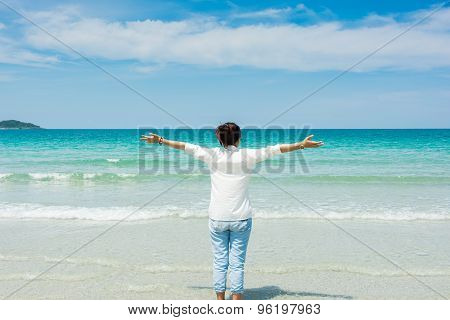 Woman In Summer Standing On Beach