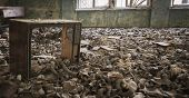 picture of gas mask  - Gas masks on the floor with an old television in an abandoned middle school in Pripyat  - JPG