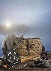 image of fly rod  - Fly rod with creel and equipment on wood table - JPG