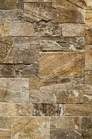 image of gneiss  - Colorful relief cladding gneiss slabs on wall closeup - JPG