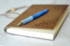 pic of leather-bound  - Leather bound journal and blue pen on marble background - JPG