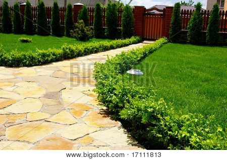 Garden stone path with grass
