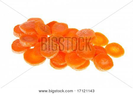 Cut carrots in slices isolated over white background