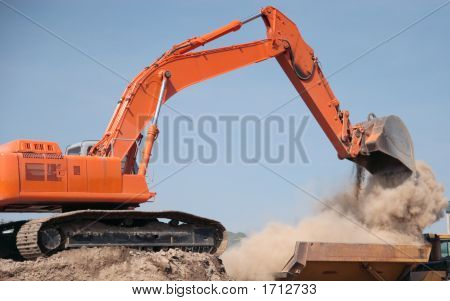 Back Hoe Construction Equipment Dumping Dirt