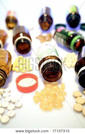 Pills spilling from bottles