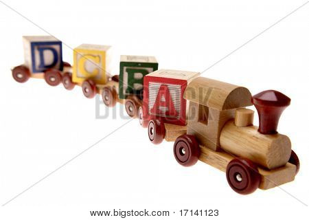 Toy train and learning blocks isolated over white
