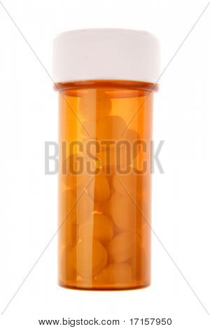 Pills in container on white background