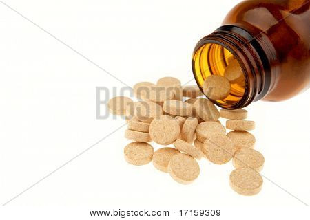 Vitamin C tablets spilling from bottle