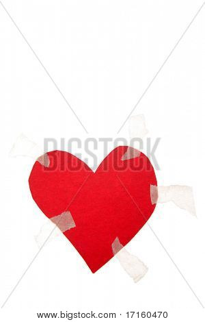 Love heart taped to white background