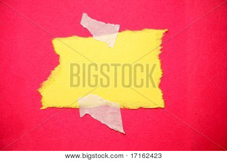 Piece of ripped paper taped to red background