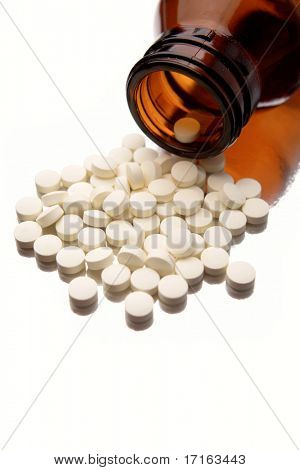Pills spilling from bottle