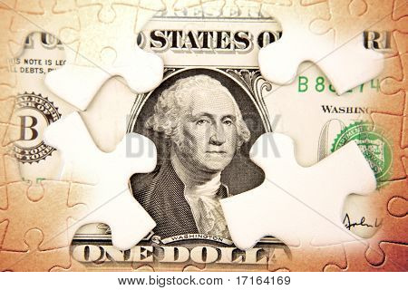 U.S. one dollar and puzzle pieces