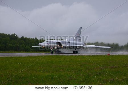 Shaikovka, Kaluga Region, Russia - July 26,2012: Routine busy day at the airbase. Flying of Tu-22M3 (a supersonic, variable-sweep wing, long-range strategic and maritime strike bomber designed by the Tupolev Design Bureau in the Soviet Union)