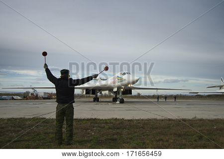 Engels, Saratov Region, Russia - November 08,2012:  Routine busy day at the airbase. Flying of Tu-160 (a supersonic, variable-sweep wing heavy strategic bomber designed by the Tupolev Design Bureau in the Soviet Union)