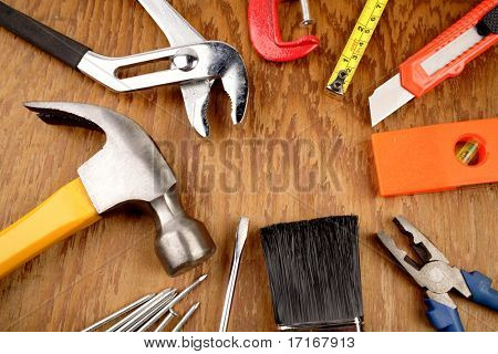 Assorted tools on wooden panel