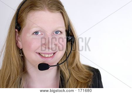 Young Woman Wearing A Phone Headset