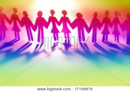 Colorful people holding hands together (blurred)