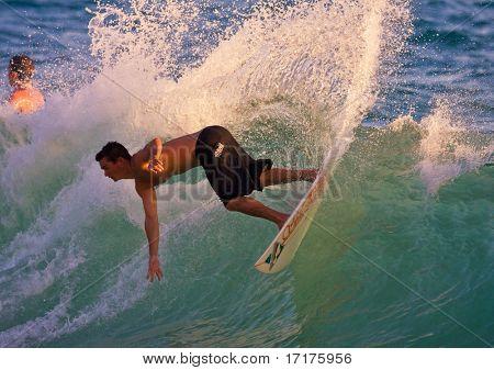 MAUI, HAWAII - JUNE 6, 2008:   Professional Skimboarder Keith Fowler carves a big turn at Makena Beach on June 6, 2008, in Makena, HI