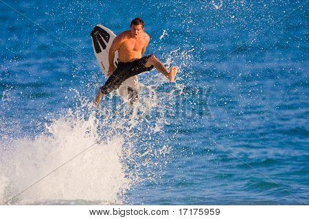 MAUI, HAWAII - JUNE 6, 2008:  Professional skimboarder Keith Fowler does a huge