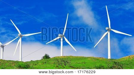 Windmills with Blue Sky and Green Hills