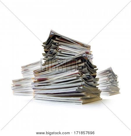 Closeup of messy piles of old magazines with bending pages