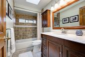 Traditional Bathroom In Brown Tones With Skylight poster