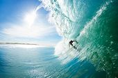 Surfer on Big Blue Ocean Wave Getting Barreled. Epic Surfing